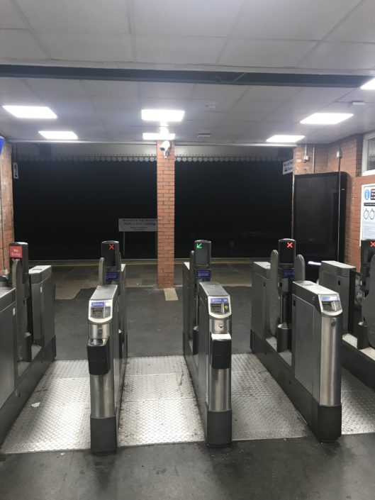 Well lit ticket gate with new LED lighting for High Wycombe station, Buckinghamshire.