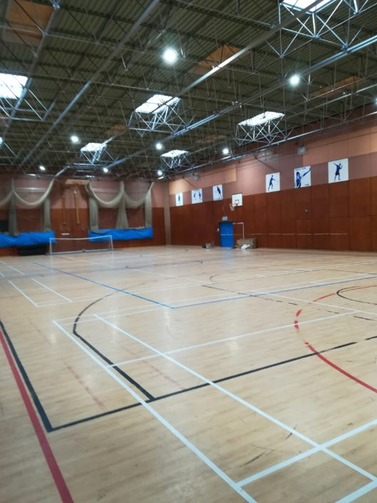 High bays lighting installation in a school sports hall at Lostock Hall Academy, south of Preston.