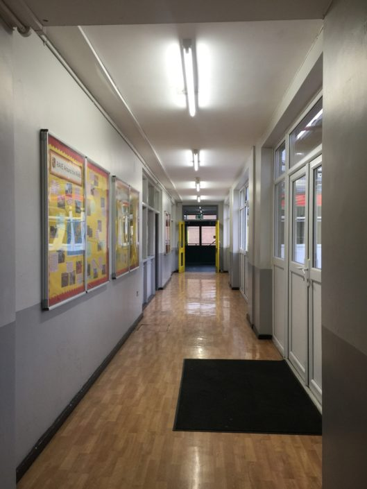Smart sensors in a Liverpool school corridor measures ambient light and movement and adjusts accordingly.