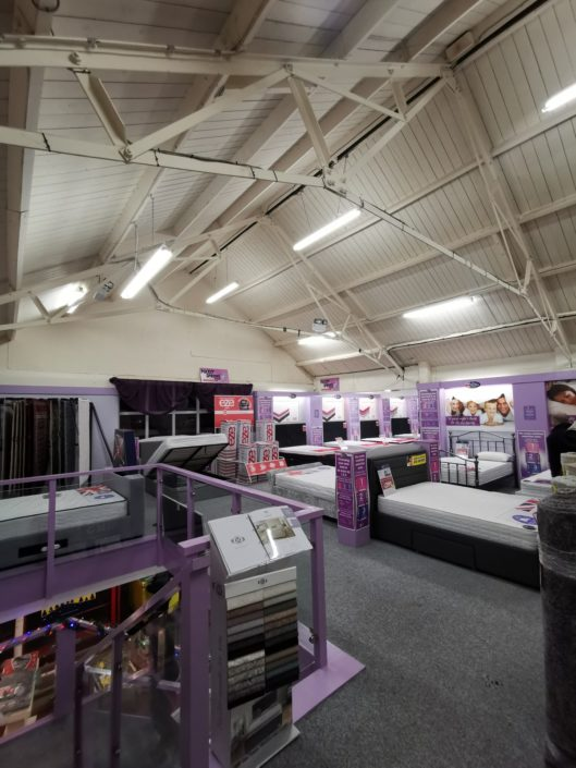 New retail lighting encourages greater conversion rates at United Carpets, Grimsby, Lincolnshire.