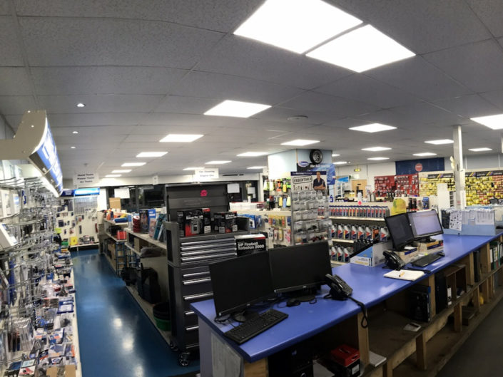 LED lighting gives energy and costs savings for Bennetts Car Parts shop in London, East England.
