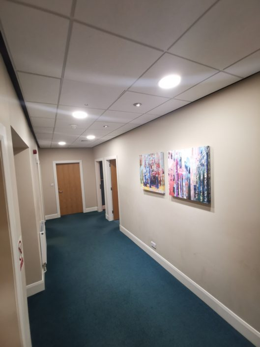 Clean LED lighting with smart sensors are ideal for internal office corridors without no natural light.