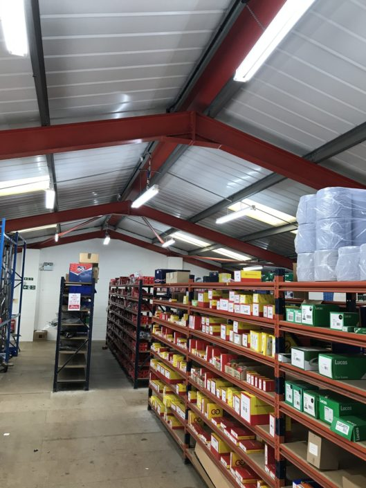 Car parts stockroom benefits from bright, crisp, led lighting in Wisbech, Cambridgeshire.