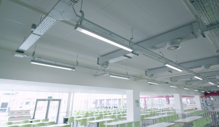 Inefficient fluorescent tubes replaced with LED lighting at Manchester high school canteen.
