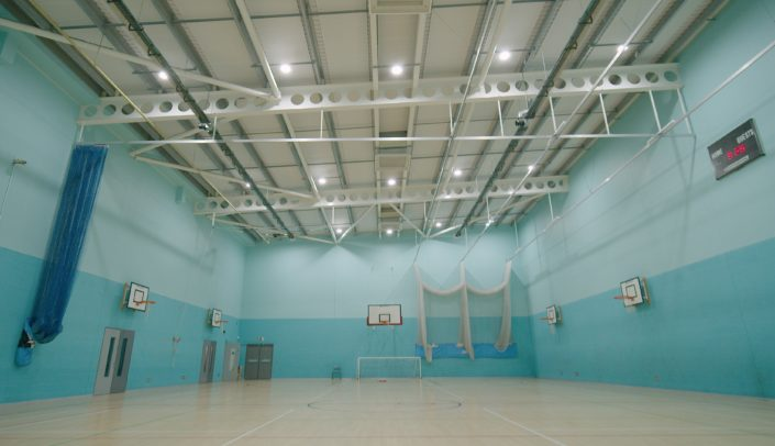 Replacement LED lighting for a school sports hall at Manchester Communication Acedemy.